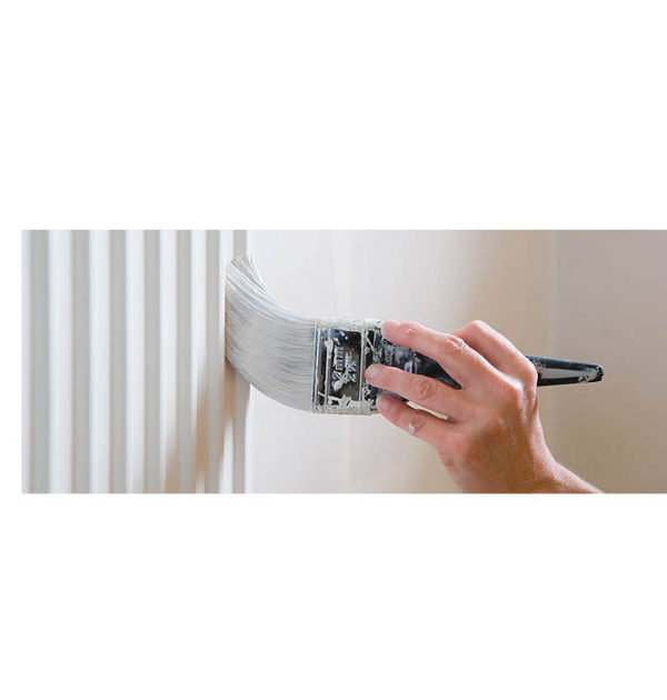 A man painting a radiator
